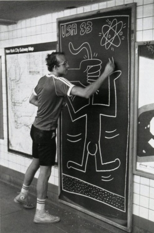 Keith working on a subway panel, Photo by Tseng Kwong Chi , 1983 © Muna Tseng Dance Projects