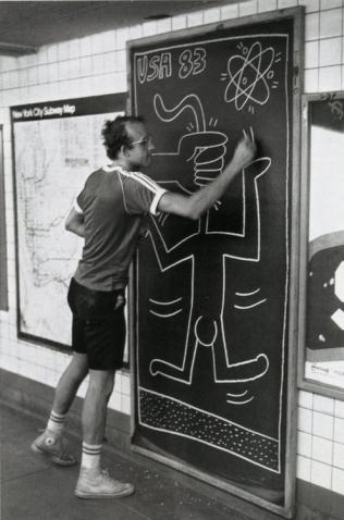 Keith working on a subway panel, Photo by Tseng Kwong Chi , 1983 © Muna Tseng Dance Projects